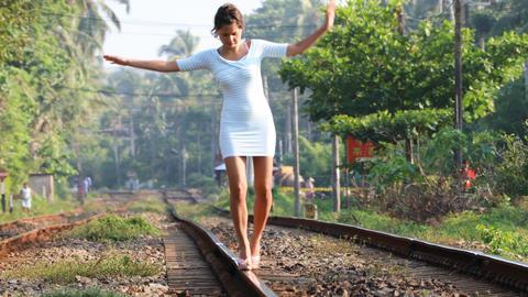 [alt video] Girl Balances on Rails