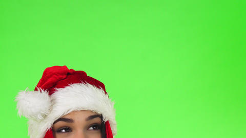 Cropped shot of the eyes of a happy Christmas girl looking at the copy space Footage