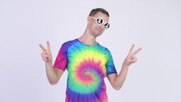 Hippie man wearing sunglasses with peace sign Footage