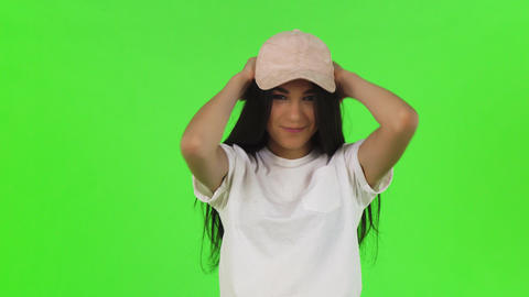 Attractive young stylish woman putting on pink baseball cap Footage