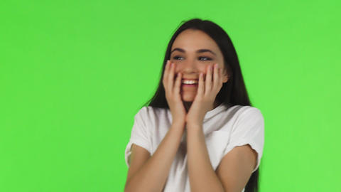 Beautiful woman looking surprised and excited on green background Live Action