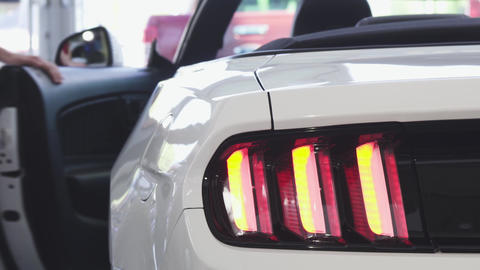 Close up of car lights flashing on a new convertible Live Action