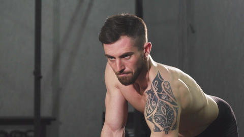 Focused young shirtless male athlete doing back workout at the gym ビデオ