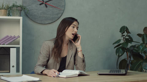 Pretty businesswoman booking an appointment GIF