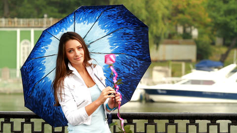 Beautiful girl posing with umbrella Stock Video Footage