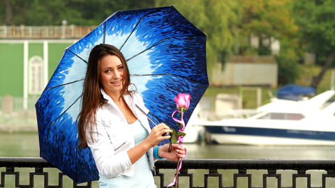 Beautiful girl posing with umbrella Footage