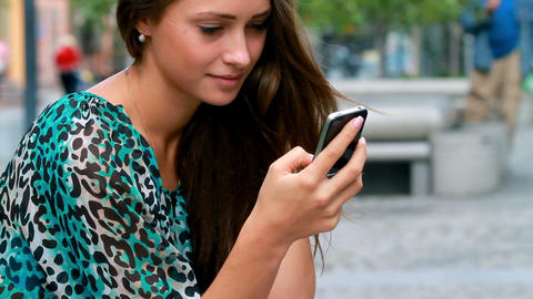 Girl typing on a mobile Footage