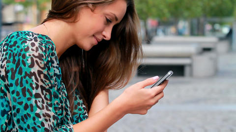 Girl typing on a mobile Stock Video Footage