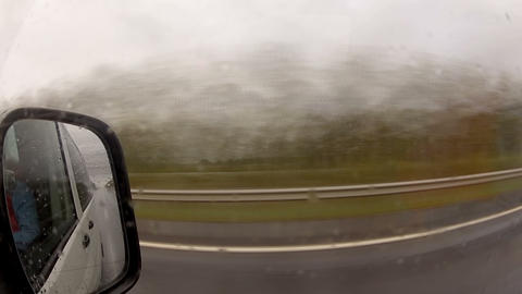 Timelapse Driving A Car In The Rain stock footage