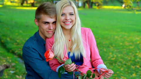young couple on background of autumn trees Footage