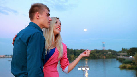 young couple on an evening promenade Stock Video Footage