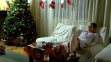 Woman Sitting On A Sofa At Christmas Evening stock footage
