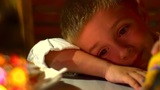 Young And Sleepy Boy At The Restaurant Table stock footage