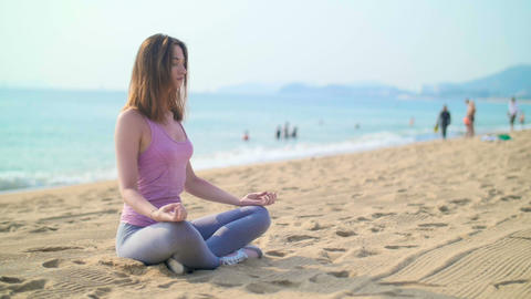Woman on vacation, meditating on the seashore Footage