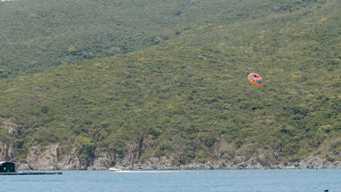 Tourists sailing on parachute in the sea Footage