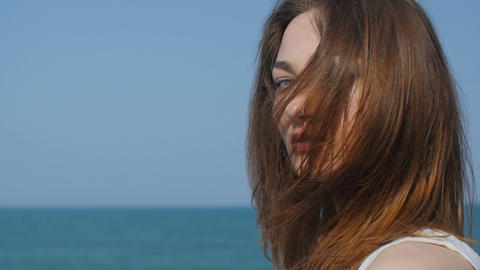 Portrait of beautiful woman on the seashore, slow motion Footage