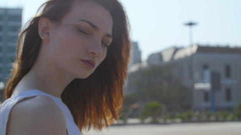 Portrait of beautiful woman looking at camera, slow motion Footage