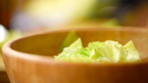Home Preparing Caesar Salad In Wooden Bowl Footage