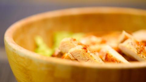 Home Preparing Caesar Salad In Wooden Bowl Footage