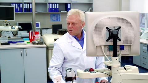 Male scientist looks to the side at the laboratory Live Action