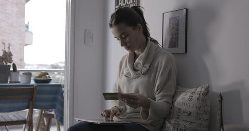 Woman with credit card writing on tablet Stock Video Footage