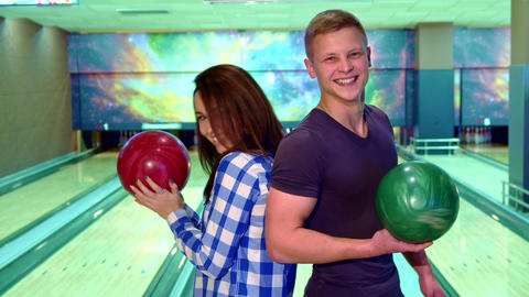 Boy and girl turn face to face at the bowling Footage