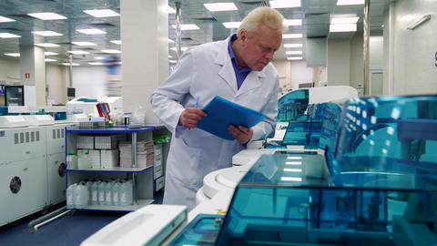 Man stands near laboratory devices Footage