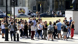 Many people crowd waiting at crosswalk street in London, UK Footage