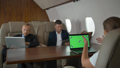 Business people have meeting in corporate jet Footage