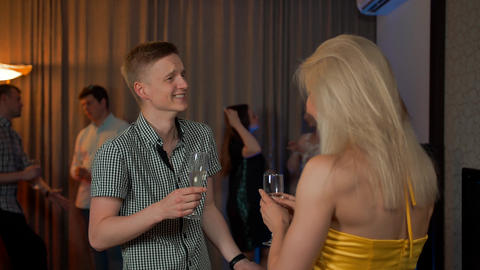 Young guy meet flirting at glamorous party with sexy female drinking champagne Footage