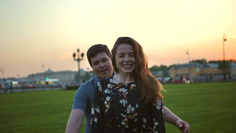 Portrait of a loving couple hugging in the park at sunrise Footage