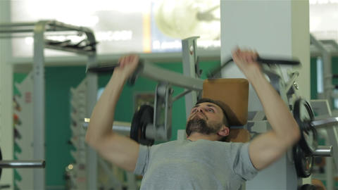 Young man doing exercise for the chest muscles Live Action