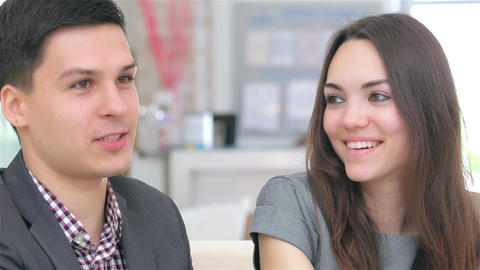 Attractive professional couple consults about their business project Live Action