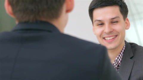 Young attractive person consults about their business project Footage