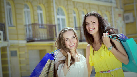 Two cute girls girlfriends happily posing with trendy... Stock Video Footage
