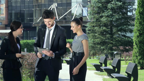 Company of three business people discussing a business... Stock Video Footage