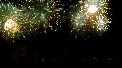 Bright stars of festive fireworks scattering over night sky, celebration Footage