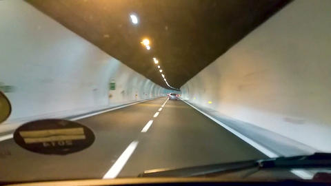 Cars driving along speed highway in brightly lit tunnel, extreme pursuit on road Live Action