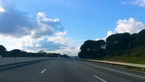 Timelapse of fast traffic on high-speed toll road, view from auto, travel by car Live Action