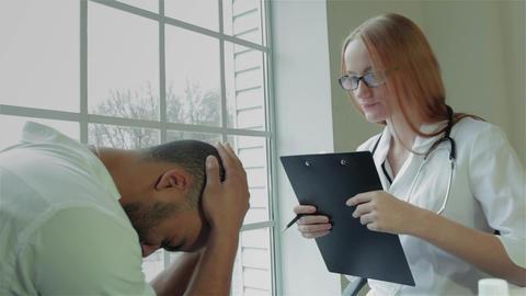 Doctor comforting her patient Footage