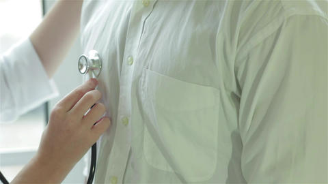 Close-up of a stethoscope on the patient's chest Live Action