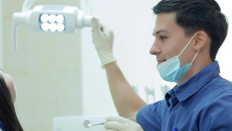 Dentist sets dental light Live Action