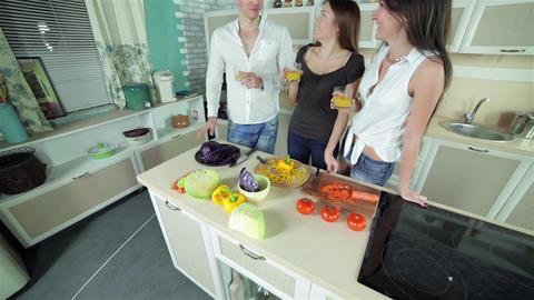Three friends gather to drink orange fresh Stock Video Footage