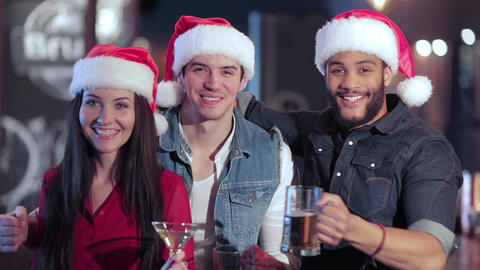 Friends in santa hat greets new friends Live Action