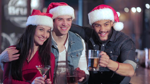 Three friends in santa hat greets new friends Live Action