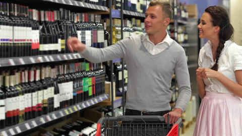 Shoppers choosing bottle of wine Footage
