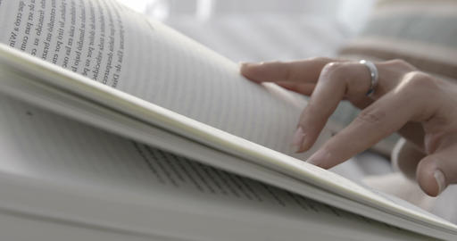 Close up reading at home next to the window - 4K Stock Video Footage