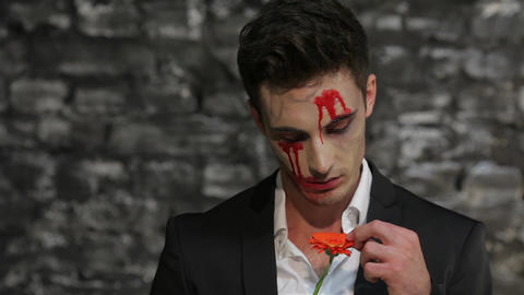 Vampire tells fortunes tearing petals Footage