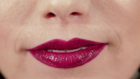 Girl blowing a kiss to her lips with red lipstick Live Action