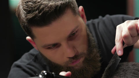 Men's hairstyling and haircutting with hair clipper in a… Stock Video Footage